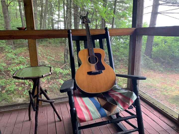 Jim039s Guitar on Porch in Woods